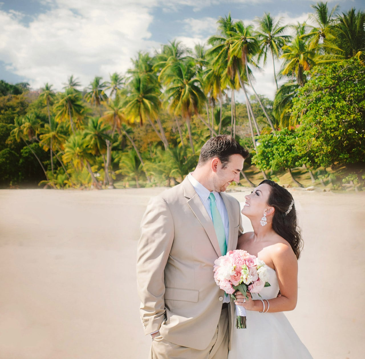 smiling married couple on beach