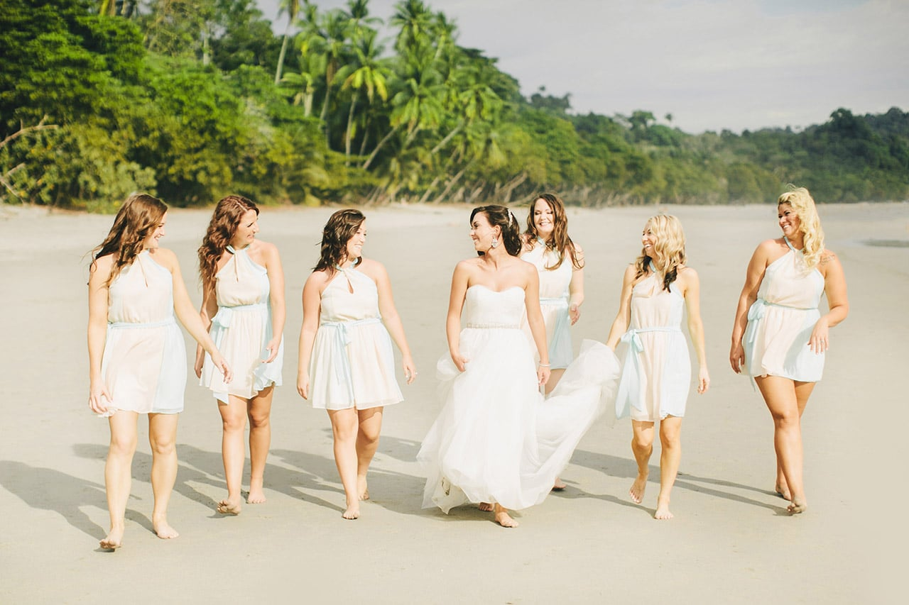 bride and bridesmaids on beach at villa punto de vista